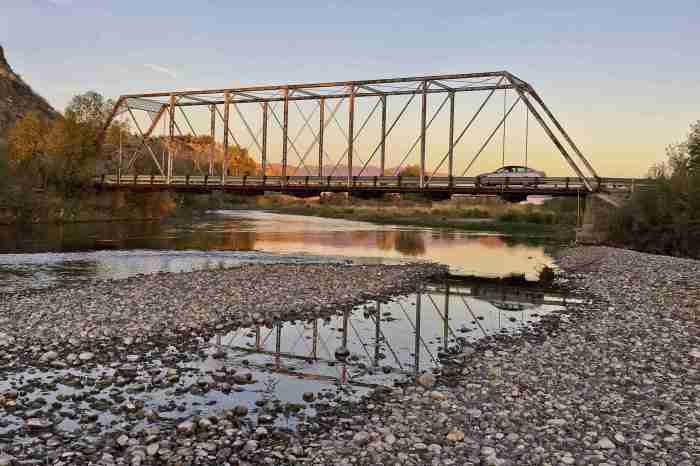 TROY CARTER/CHRONICLE A car drives over the Nixon Bridge above the East Gallatin River near Manhattan on Tuesday, Oct. 6. Gallatin County Commissioners approved Tuesday an engineering study for its replacement.