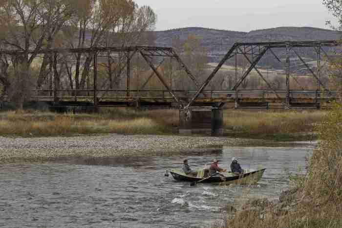 TROY CARTER/CHRONICLE Anglers row on the Jefferson River just before the Williams Bridge near Willow Creek on Saturday, Oct. 24. Six one-lane truss bridges, including the Williams Bridge, have been designated structurally obsolete according to the Gallatin County Road and Bridge Department.
