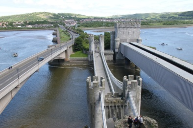 The bridges at Conwy. On the right is Stephenson's tubular bridge. In the middle is Telford's suspension bridge. The bridge on the left is the road bridge which replaced Telford's, carrying the A58 road. © David Humphreys (used with permission) and on Flickr, here